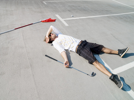 Golfer Lying In Car Park