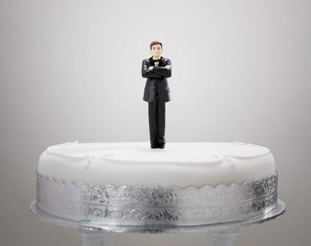 Bridegroom Figurine On A Cake LANG_EVOIMAGES