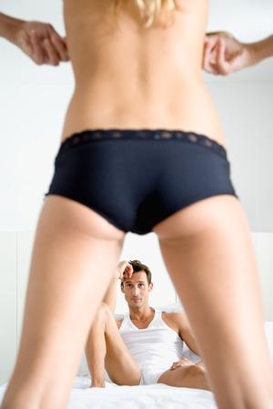 Man Watching Woman Undress