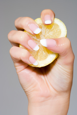 Woman Squeezing A Lemon LANG_EVOIMAGES