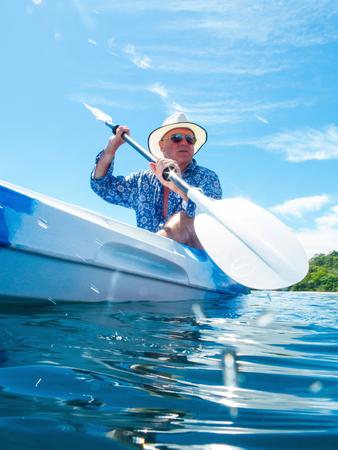 Man kayaking, Ban Koh Lanta, Krabi, Thailand, Asia