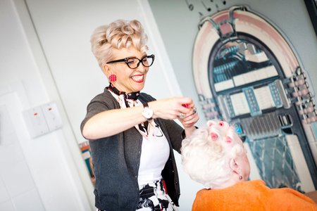 Woman working in quirky hair salon LANG_EVOIMAGES