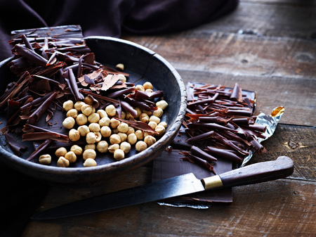 Chocolate shavings and hazelnuts in bowl