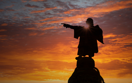 Silhouette of pointing statue at sunset, Barcelona, Catalonia, Spain, Europe