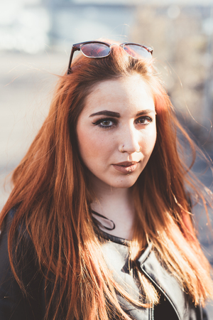 Portrait of red haired looking at camera