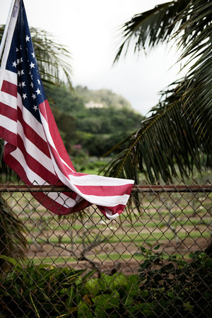 american flag hanging by chain fence lang evoimages hanging american flag stock photos  royalty free business images  rh   123rf