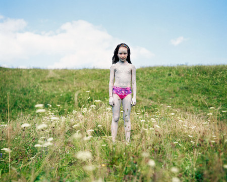 Portrait of a girl standing in a meadow, Nowica, Poland