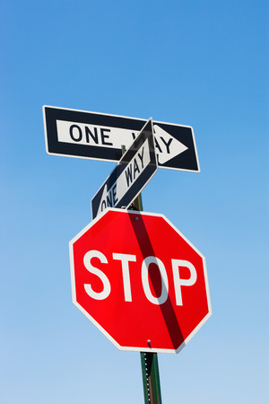 Stop sign and one way signs