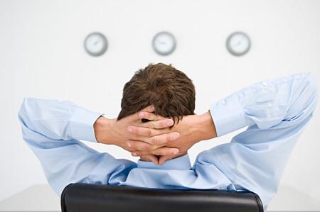 Relaxed businessman watching clocks