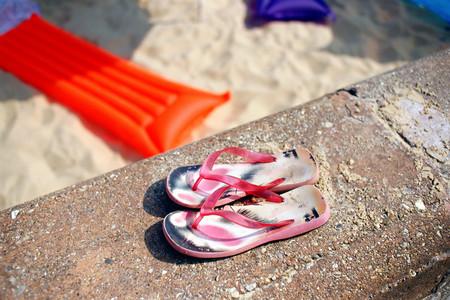 Flip-flops on the beach LANG_EVOIMAGES