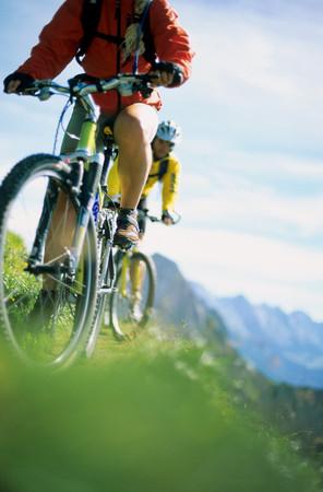 People mountain biking LANG_EVOIMAGES