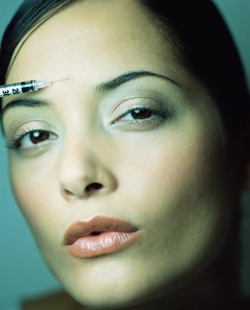 Woman having a botox injection
