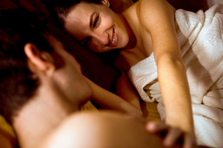 Couple hugging in bed LANG_EVOIMAGES