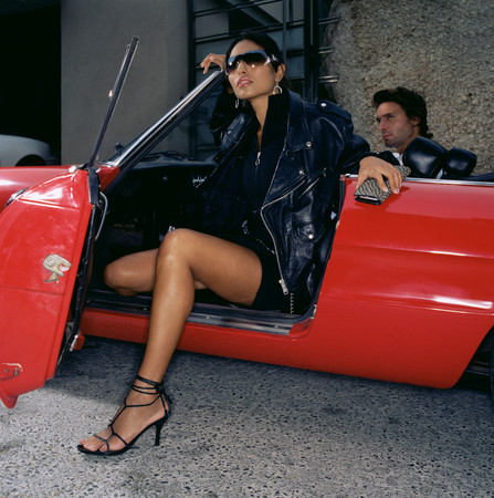 Woman stepping out of a convertible LANG_EVOIMAGES