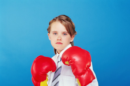 Girl wearing boxing gloves