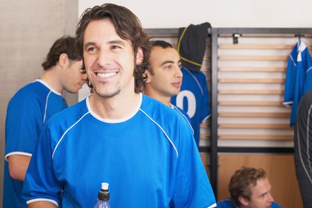 Smiling footballer LANG_EVOIMAGES