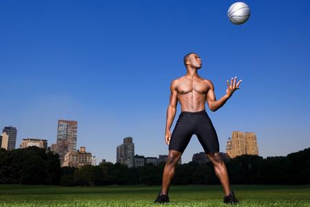 Man throwing basketball LANG_EVOIMAGES
