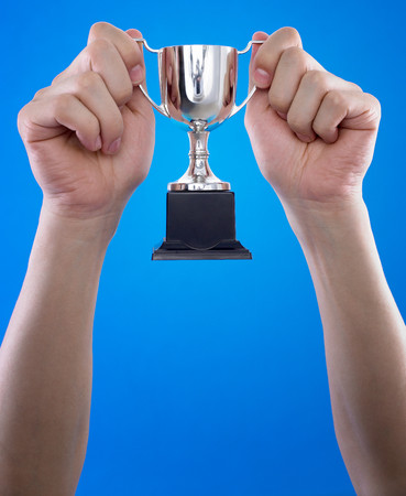 Person holding a trophy