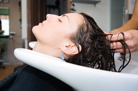 Woman having hair washed LANG_EVOIMAGES