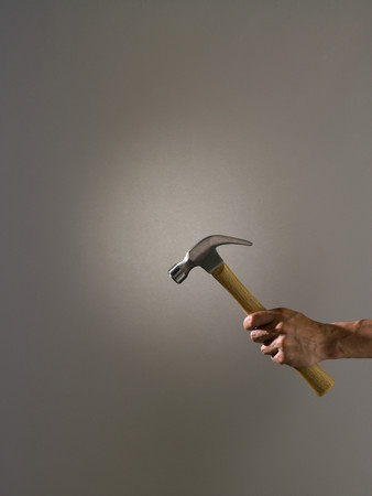 Person holding a hammer