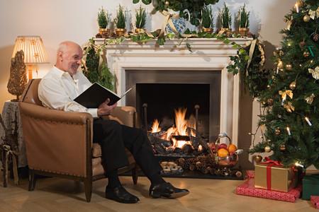 Man reading a book at christmas