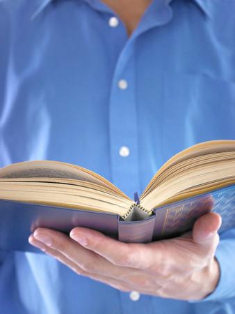Man holding a book LANG_EVOIMAGES