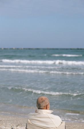 Senior man looking at waves