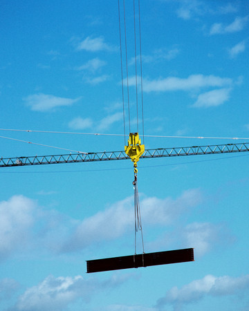 Industrial crane holding a girder
