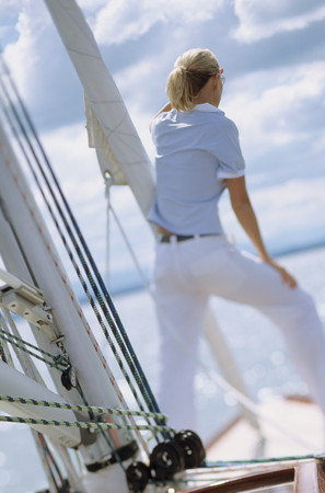 Rear view of woman on boat looking out to sea