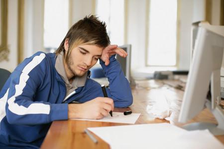 Man drawing at his desk