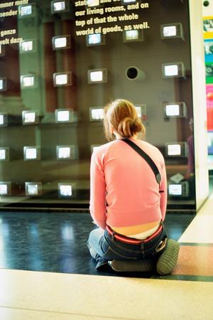Girl kneeling in art gallery