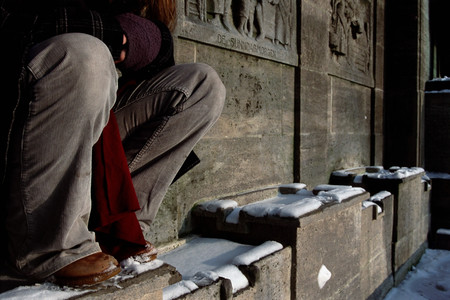 Man sitting on carved wall