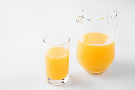 A glass of orange juice LANG_EVOIMAGES