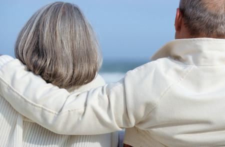 Senior man with arm around senior woman