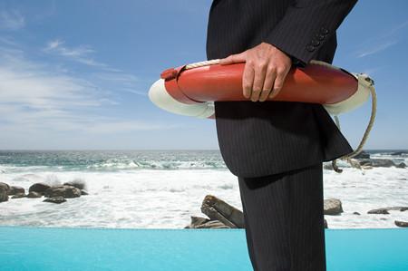 Businessman wearing a lifebelt