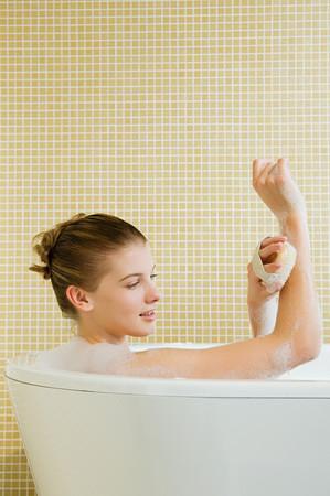 Woman using massage brush