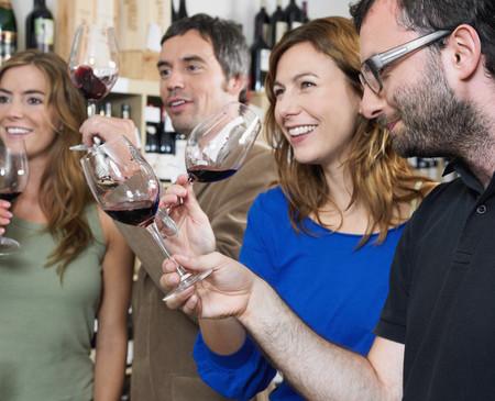 Group of friends at wine tasting LANG_EVOIMAGES