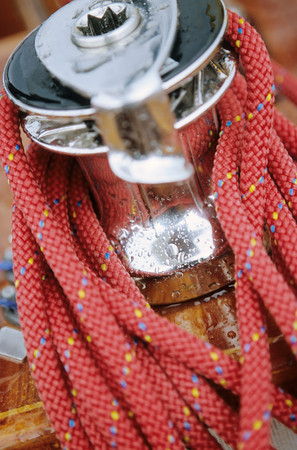 Close-up of red rope around crank