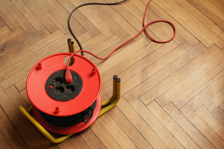 Extension cord and sockets on floor LANG_EVOIMAGES