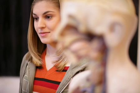 Young woman with anatomical model LANG_EVOIMAGES