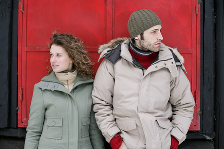 Couple standing outside a hut