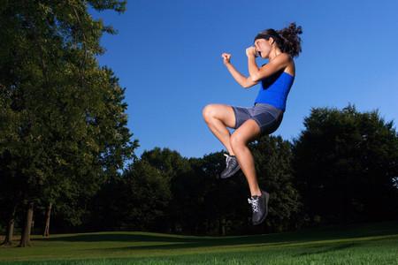 Woman practicing kick boxing