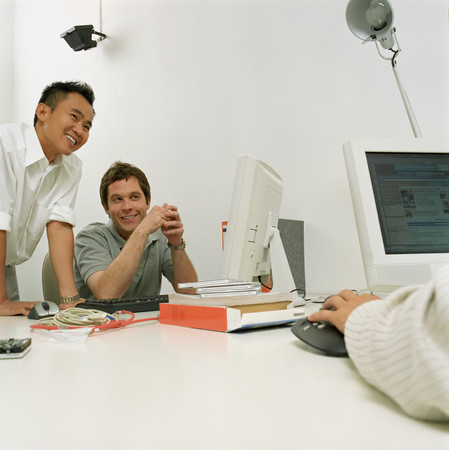 Male office workers smiling