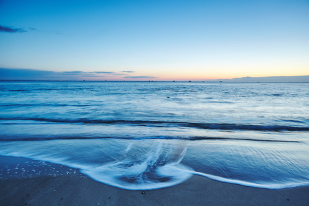 Lapping waves on beach at sunset, Odessa, Odessa Oblast, Ukraine, Europe