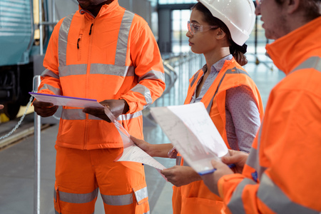 Apprentices in meeting at railway engineering facility