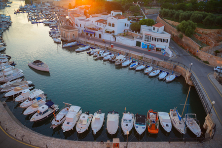 High angle view of historic harbour and rows of moored boats, Ciutadella, Menorca, Balearic Islands, Spain
