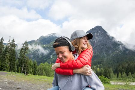 Woman hugging teenage son in rural setting LANG_EVOIMAGES
