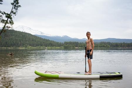 Teenage boy on paddleboard