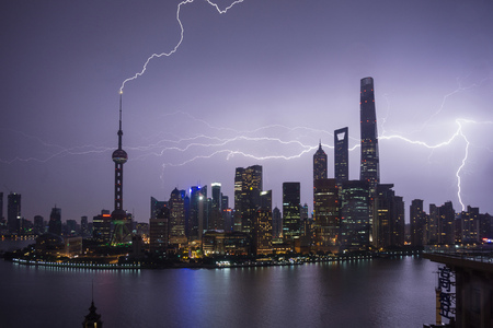 Elevated cityscape with lightning striking oriental pearl tower at night, Shanghai, China