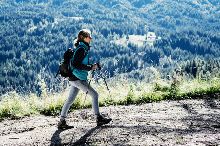 Woman hiking, Madonna di Pietralba, Trentino-Alto Adige, Italy, Europe LANG_EVOIMAGES